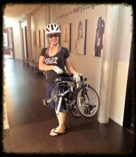 AKT trainer Ariel, and her helmet, prefer her travel-friendly foldable bike.
